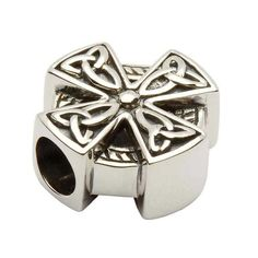 Combining two beloved symbols of Ireland, this delicately etched bead from the Tara's Diary collection is essential for any fan of the Irish Spiritual Tradition. Crafted from sterling silver, each of the arms of the Celtic Cross are adorned with a tri-cornered Celtic Knot. An engraved circle halos the cross and completes the familiar design.A Merging of Two SymbolsIt is said that when St. Patrick traveled to Ireland, the Irish worshiped the sun. St. Patrick superimposed the Christian…