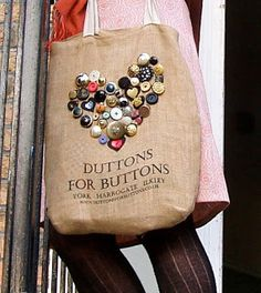 Duttons is a much loved and enduring button shop in the North of England (the parent company was established in Leeds in 1906). One of the girls who works there had this great idea - to print a picture of buttons onto a re-usable hessian bag so that customers could then sew their own favourite buttons onto the bag.
