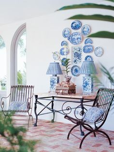 blue and white plates on walls, outdoor room