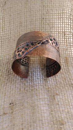 Copper form folded cuff.  Super cute.https://www.etsy.com/listing/191097318/copper-form-folded-cuff