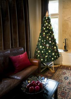 An alternative Christmas tree by The Jubiltree Company, decorated with green feather boas, but it looked so traditional. One of our proudest achievements!  | The Jubiltree Company, LLC  | Modern Wood Christmas Trees