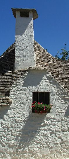 "A ""trullo"" (a traditional dry stone hut with a conical roof) by grigand in Alberobello, a small Italian town in Puglia."