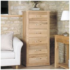 this oak furniture tallboy has six drawers and is made of solid oak this piece chadwick satin lacquered oak hidden home