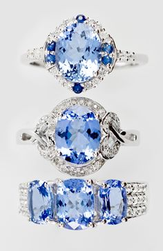 Tanzanite's striking blue pairs beautifully with white diamonds and zircon in these rings.