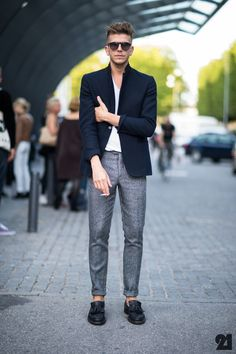 Shop this look on Lookastic:  http://lookastic.com/men/looks/navy-blazer-and-white-v-neck-t-shirt-and-black-tassel-loafers-and-grey-dress-pants/565  — Navy Wool Blazer  — White V-neck T-shirt  — Black Leather Tassel Loafers  — Grey Wool Dress Pants