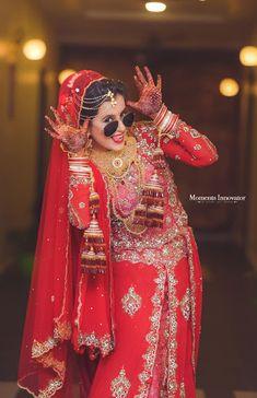 "Moments Innovator ""Portfolio"" Bridal Makeup - Bride Wearing a Silver Choker with a Green Emerald and Bronze Makeup, Gold Jewelry Tikka. WeddingNet #weddingnet #indianwedding #makeupandhair #weddingmakeup #weddinghair #hairbun #maangtikka #jewelry #goldjewelry"