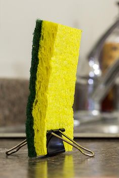 To keep your kitchen sponge upright so it can dry mold/slime free - 20 DIY Binder Clip Hacks That Will Change The Way You Use Them