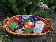 woll pouches wet-felted around river rocks