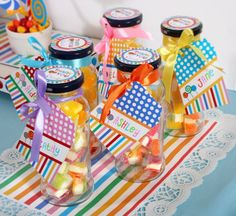 candyland birthday party of rainbow colored sweets favor bottle tags