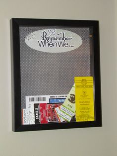 A Shadow Box made for all of our ticket stubs from concerts, games, travels etc.  Hard to see, but the glass is even etched.