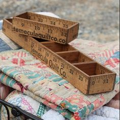 Upcycle Yardsticks or rulers to Small object storage; featured at totallygreencrafts.com #upcycle #repurpose #crafts #DIY
