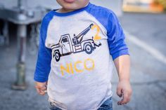 This is a custom tow truck birthday shirt for your transportation fan! This shirt is made to order we can customize the numbers on the tow truck and your childs name! The pictured shirt is blue/gray raglan and is 3/4 length sleeves in sizes 2T- Youth XL, the 12M-24M is a short sleeve bodysuit. navy/grey raglan (please note in some lighting it does look very dark almost grey due to the vintage style)  ***please add name and age to the comments when checking out****   **Please check shop…