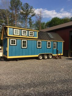 The Blueridge: a beautiful blue home on wheels, designed and built by Timbercraft Tiny Homes for a family of three from California.