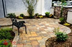 Belgard's Catalina Slate pavers were installed in this homes outdoor spaces.These natural-looking slate pavers in colors Bella & Victorian offer a charming earthy hue.