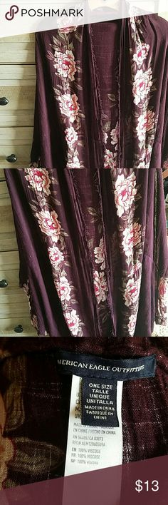 American Eagle cardigan Beautiful floral wrap. Scoops in the back, making it longer for extra coverage. Flowy arms. American Eagle Outfitters Tops