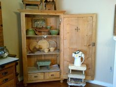antique pine cupboard with 2 vents in front door - built-in drawers inside.