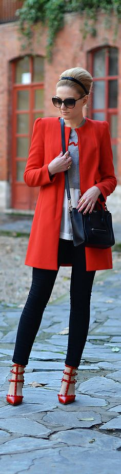 Red coat, white top, black skinnies, red ankle strap skinnies, black handbag