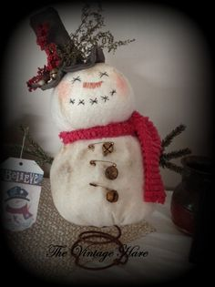 """Sam the Snowman is adapted from a pattern by Sandy Schmidt. Mounted on a rusty automotive spring. Faux Victorian pine boughs are used for his arms. Sam is accented with rusty jingle bells, rusty safety pins, sweet annie, red berries. Sam measures approximately 15"""" tall.  $34.88 plus shipping. #trending #Christmas #hafair #statteam #TeamUNITY  https://www.etsy.com/listing/169267281/primitive-grunged-sam-the-snowman-rusty?ref=related-3"""