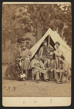 [Group portrait of soldiers in front of a tent, possibly at Camp Cameron, Washington, D.C.]