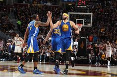 JaVale McGee of the Golden State Warriors high fives Andre Iguodala during the game against the Cleveland Cavaliers in Game Three of the 2017 NBA...