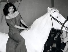 1970s: Bianca Jagger's Halston maxi dress. Worn at her birthday party at Studio 54 in 1977, this red maxi dress, designed by It brand Halston, embodied the over-the-top glamour of the era.