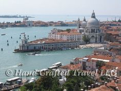 Travel Picture: Day 202. Another view from the bell tower of Saint Mark's Basilica in Venice, Italy. This one looking towards the old customs house at the point of Giudecca Island, and the massive dome of Santa Maria della Salute (Saint Mary of Health) church. One of the last major building projects in Venice's history, the foundation for the church required 1 million tree trunks, used as pilings driven into the lagoon bottom.