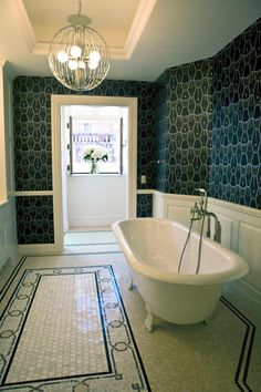 The richness of the wallpaper adds so many dimensions to this bathroom.  Stunning!