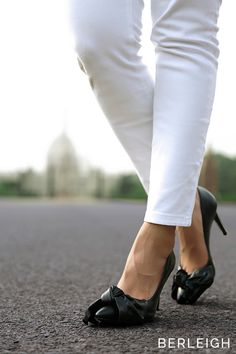 e7c318507bd Schutz black bow pumps  An oversized bow stunningly drapes around the charm  of this classically
