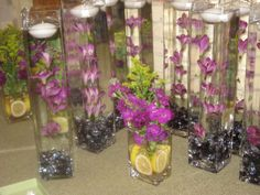wedding center pieces, we made these for my cousins wedding, the tall ones have flowers strung on fish line so that they look suspended in the water, so pretty!