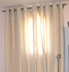 drop cloth grommet DIY curtains-- love the texture and color of drop cloth, great idea