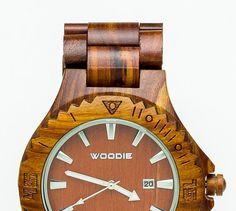 100% Hand Made Mens Wood Watch Made from Red Sandalwood. Each watch is Unique Because No two Pieces of Wood Are the Same.