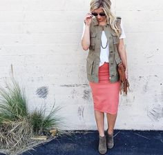 One of my favorite things to do is combine different styles and looks together that typically don't go together. This is what I love about this. It combines a chic pencil skirt and white tee with a cargo military style vest. Killing it!