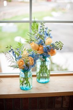 Peach and blue centerpieces. Peach roses and blue delphinium. These are pretty maybe something like this for the aisle decorations?