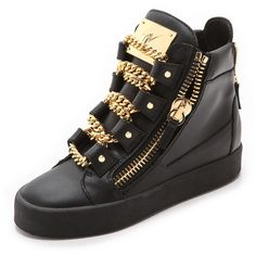 These leather Giuseppe Zanotti high tops are trimmed with chunky, gold tone curb chains at the front, and matching exposed zippers fasten the gusseted sides. O…