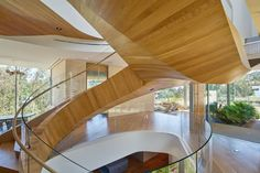 Helical Staircase Makes an Eccentric Centerpiece in this LA Family Home - http://freshome.com/helical-staircase-centerpiece-in-LA-home/
