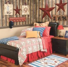 Red and black stars in Jacks room.  Also, Pony Express tin sign.  Black iron bed.  Plaid bedding.  Black night stand with wood top and cup pulls.  Some beadboard.