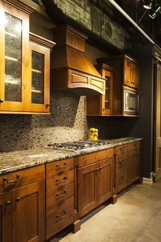 Kitchen Showroom Design - Requarth Co. Mid Continent Cabinetry-Rustic Alder-harvest with black glaze Kitchen Cabinet Makers, Kitchen Cabinets, Kitchen Designs, Kitchen Ideas, Mid Continent, Kitchen Showroom, Showroom Design, Craftsman Kitchen, Glaze