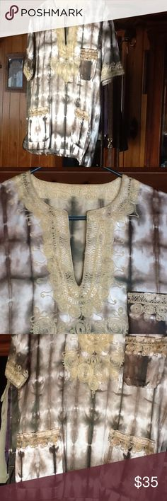 "SZ S tide eye tunic with gold lace "" VINTAGE"" 1 Gorgeous size S  straight cut ,slightly below hip with gold sewn lacing Cream and bronze colors shiny thicker material very VINTAGE gently used ,excellent condition  !⌚️19 width one side 24 in length Tops Blouses"