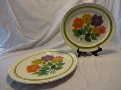 """Just in time for Spring, this beautiful floral pattern is lively and colorful and begging for a dinner date. Purple, mustard, orange, pink and greens are featured in this pattern. Produced by Franciscan in the late 60s and early 70s.  Measures 13.5"""" long x 11.5"""" wide."""