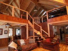 Large Doug Fir beams and wrought iron rails, help to make this custom home unique. The loft and recreation room above allows for friend to enjoy a game of pool or a board game, and yet visit with those in the living room. Open concepts also make the home feel larger than they really are.