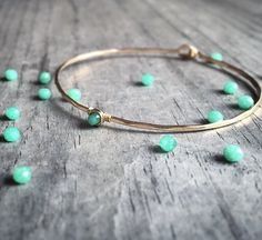 A personal favorite from my Etsy shop https://www.etsy.com/listing/179228100/chrysoprase-bangle-14k-or-rose-gold