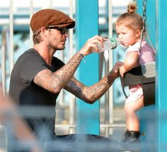 David Beckham made sure his daughter, Harper, kept hydrated while playing on the swing set at a park in New York on Sept. 10, 2013.