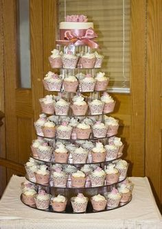 Small Cake on top with cupcakes  below...great idea!