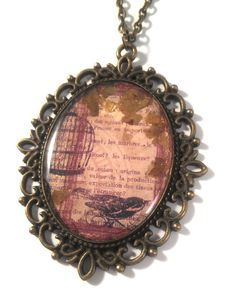 Crow with Birdcage in resin with Gold flecks on Bronze Lace Pendant on Necklace by JujusCrafts