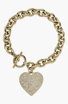 Nordstrom.com. Michael Kors engraved heart-shaped charm. A bright shine especially shows off this versatile rolo-chain bracelet that'll last you for years.