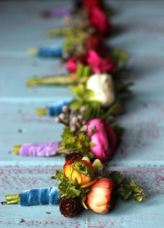 Colourful boutonnieres More inspiration on WonderWed.de
