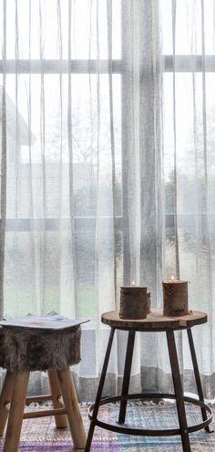 sheer curtains, concrete + rug | \