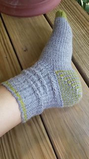 These socks are crocheted using a split single crochet stitch. The resulting sock looks, feels and stretches like a knit sock. They are super comfortable and long wearing.