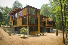 This house was designed by Joel Turkel. The Dwell NextHouse Model Home is a 5000 square foot, light-filled modern structure on a 13-acre site. The home has 4 bedrooms, 4.5 baths, and a kitchen/dining/living area with adjoining decks on the main level, family room and office. It includes.....