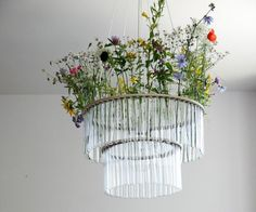 Test-Tube filled with Flowers (and other examples) of 25 unusual upcycled Chandeliers